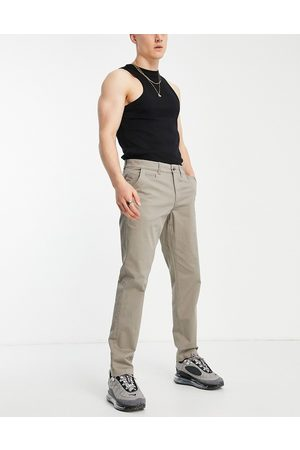 New Look Muži Chino - Slim chino trousers in dark grey
