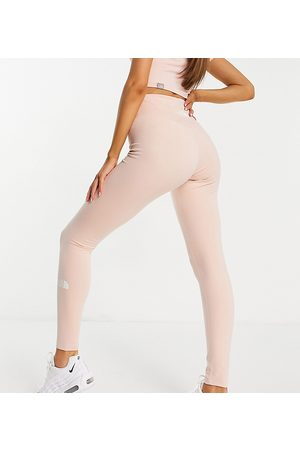 The North Face High Waisted legging in light pink Exclusive at ASOS