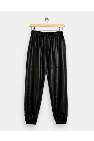 Topshop Faux leather jogger in black