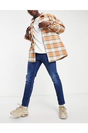 ASOS Muži Slim - Stretch slim jeans in dark wash blue