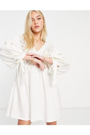 ASOS Mini dress with volume sleeves and embroidery neckline-White