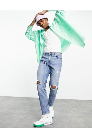 ASOS Stretch tapered jeans in tinted mid wash with knee rips-Blue
