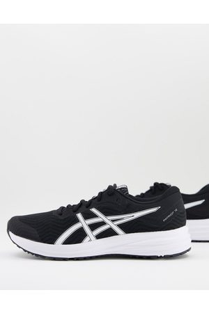 Asics Running Patriot 12 trainers in black and white