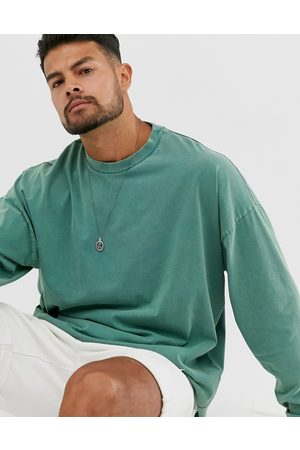 ASOS Oversized longline long sleeve t-shirt with acid wash in green