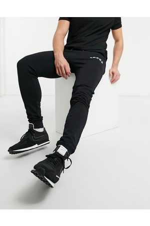 ASOS Super skinny joggers with side print in black