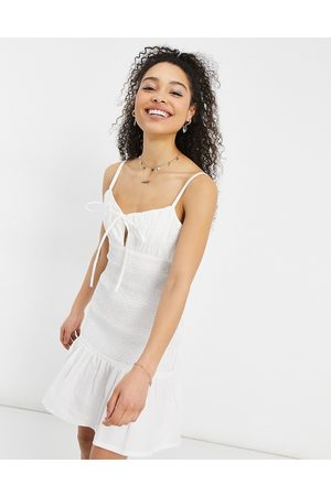 ASOS Ruched bust cami mini sundress with shirred waist in cotton poplin in white-Cream