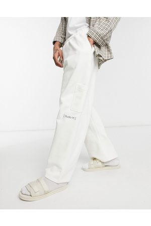 ASOS Muži Tepláky - Co-ord tapered joggers in heavyweight with small print detail-White