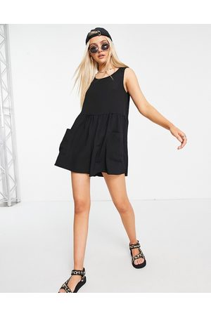 ASOS Smock sleeveless textured playsuit with pockets in black