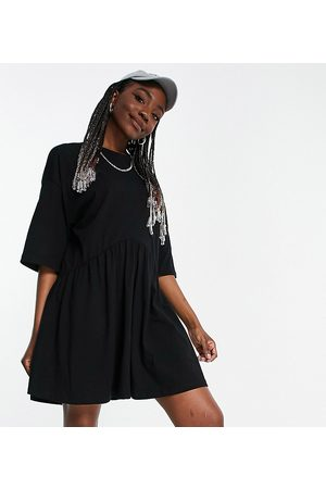ASOS ASOS DESIGN Tall oversized mini smock dress with dropped waist in black