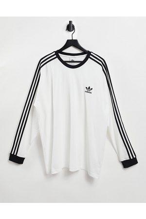 adidas Adicolor three stripe long sleeve t-shirt in white