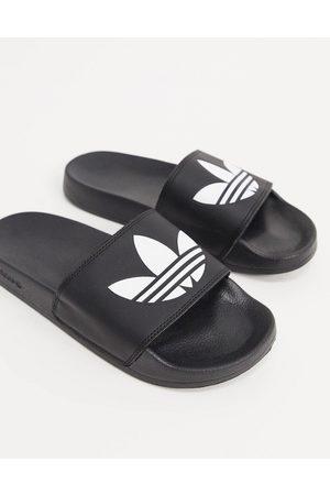 adidas Adilette slides in black