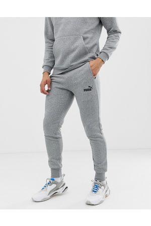 PUMA Muži Tepláky - Essentials small logo slim joggers in grey