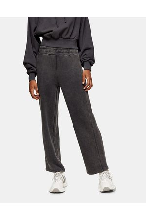 Topshop Ženy Tepláky - Straight leg joggers in acid wash black-Brown