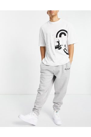 ASOS Muži Tepláky - Co-ord oversized joggers in grey marl with printed logo-White