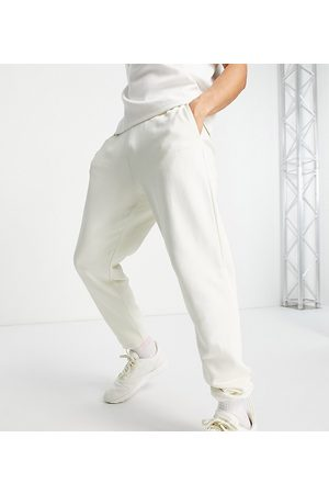 Reebok Classics joggers with central logo in off white exclusive to ASOS