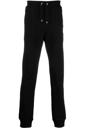 Balmain Muži Tepláky - Embroidered-design track pants