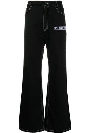 Natasha Zinko Slogan appliqué flared jeans