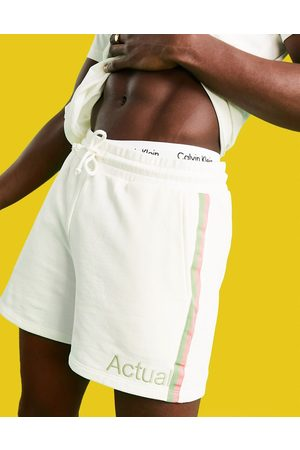 ASOS Athleisure co-ord jersey shorts in ecru with printed logo and side stripes-White