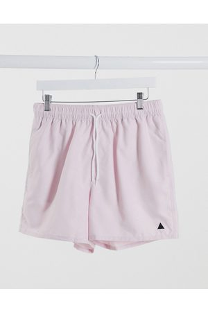 ASOS DESIGN Swim shorts in pink with triangle embroidery short length