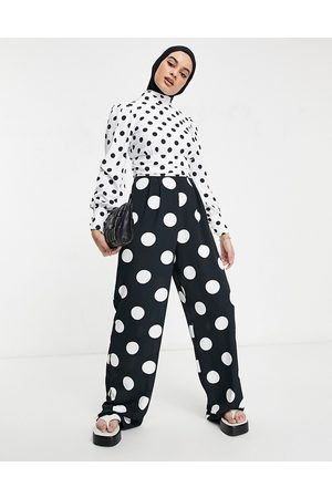 ASOS Ruched waist detail jumpsuit in mixed spot print-Multi