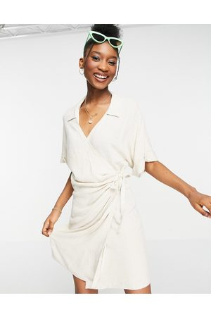 ASOS Ženy Na párty - Linen wrap mini dress in natural-White