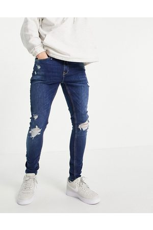 River Island Spray on jeans with rips in mid blue