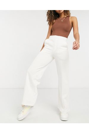 ASOS Ženy Široké nohavice - Wide leg joggers with button front detail and pintuck-White