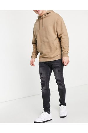 Topman Extreme blowout skinny jeans in washed black