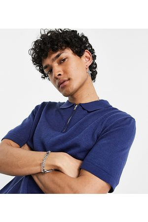 Reclaimed Vintage Inspired the Short Sleeve Knitted 1/4 Zip Polo in Navy-White
