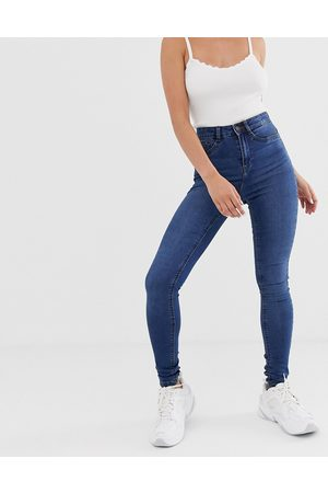 Noisy May High waisted skinny jeans in mid blue wash