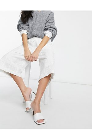 Native Youth Longline linen trousers in white
