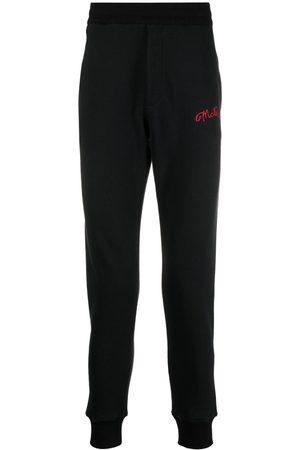Alexander McQueen Muži Tepláky - Embroidered logo track pants