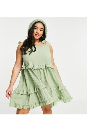 ASOS ASOS DESIGN Curve textured ruffle swing mini sundress with tie straps in khaki-Green