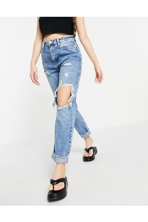 River Island Carrie super distressed mom jeans in mid auth blue