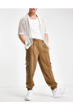 ASOS Oversized tapered cargo smart trousers in khaki crepe-Green