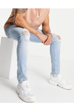 ASOS Skinny jeans in light wash blue with knee rips