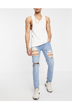 ASOS Muži Skinny - Skinny jeans in mid wash blue with heavy rips