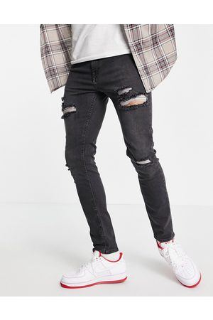 ASOS Skinny jeans in washed black with heavy rips