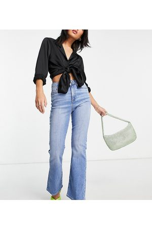 ASOS ASOS DESIGN Petite high rise 'Y2K' stretch flare jeans in bright midwash-Blue