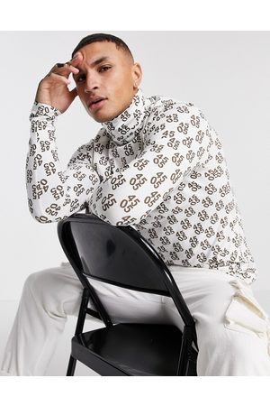 ASOS Muscle fit long sleeve t-shirt with roll neck and all over logo-White