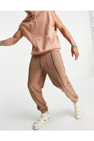 ASOS Reversible oversized jogger with seam detail-Brown