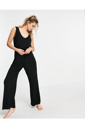 ASOS Mix & match lounge super soft rib jumpsuit with waist tie in black