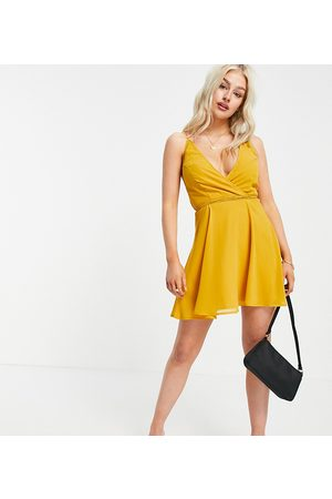 ASOS ASOS DESIGN Petite cami wrap mini dress with lace up back in mustard-Yellow