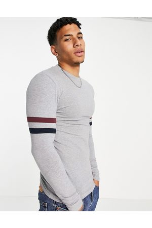 ASOS DESIGN Muscle fit long sleeve t-shirt in grey marl organic cotton with sleeve stripe