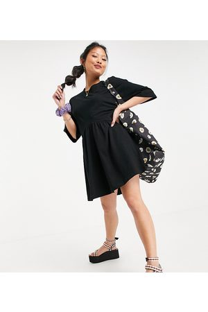 ASOS ASOS DESIGN Petite oversized mini smock dress with dropped waist in black