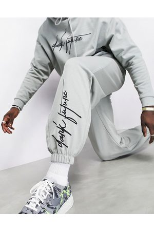 ASOS Oversized joggers in grey with logo print