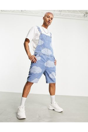 ASOS Short denim dungarees in mid wash blue with cloud print