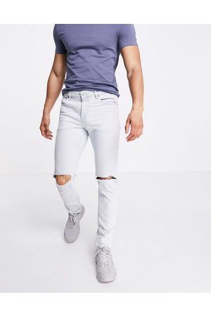 ASOS DESIGN Stretch slim jeans in flat light wash blue with knee rips