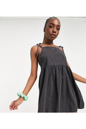 ASOS ASOS DESIGN Tall soft denim smock pinny dress in washed black