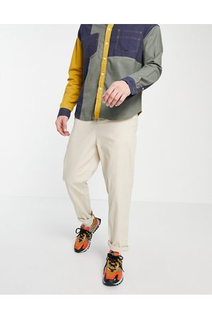 ASOS Muži Chino - Relaxed skater chinos in beige-Neutral